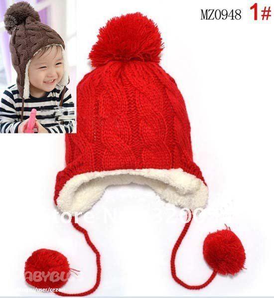 зимняя вязанная детская шапочка ушками